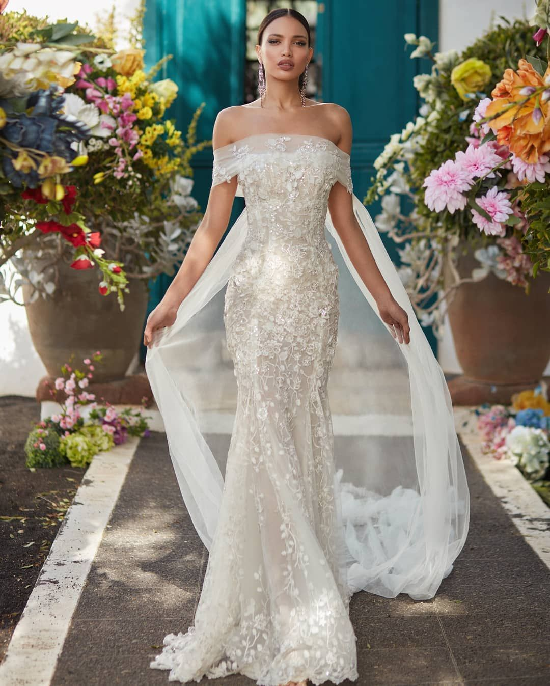 Bridal gown has a silvery shimmer to it off the shoulder