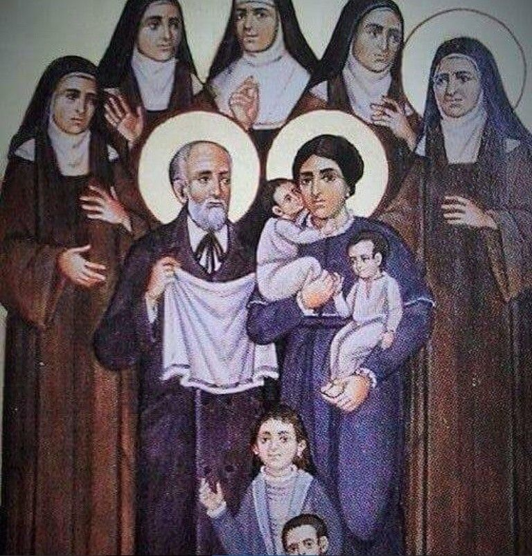 Saints Louis and Zelie Martin with their 5 surviving daughters (including St Therese) and their 4 children who died in infancy or who were miscarried.