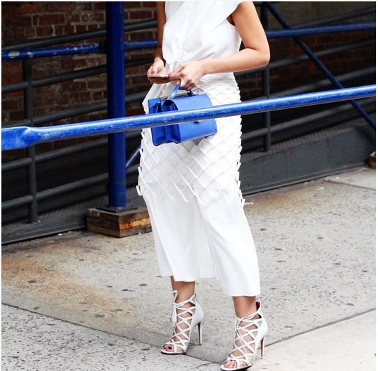 If another case needs to be made to wear white after Labor Day, Liz Yu makes it in Tibi's Agathe Bow Jumpsuit outside NYFW SS16 shows.