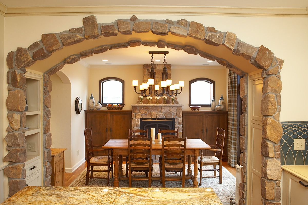 stone archway between kitchen & dining room | dream home