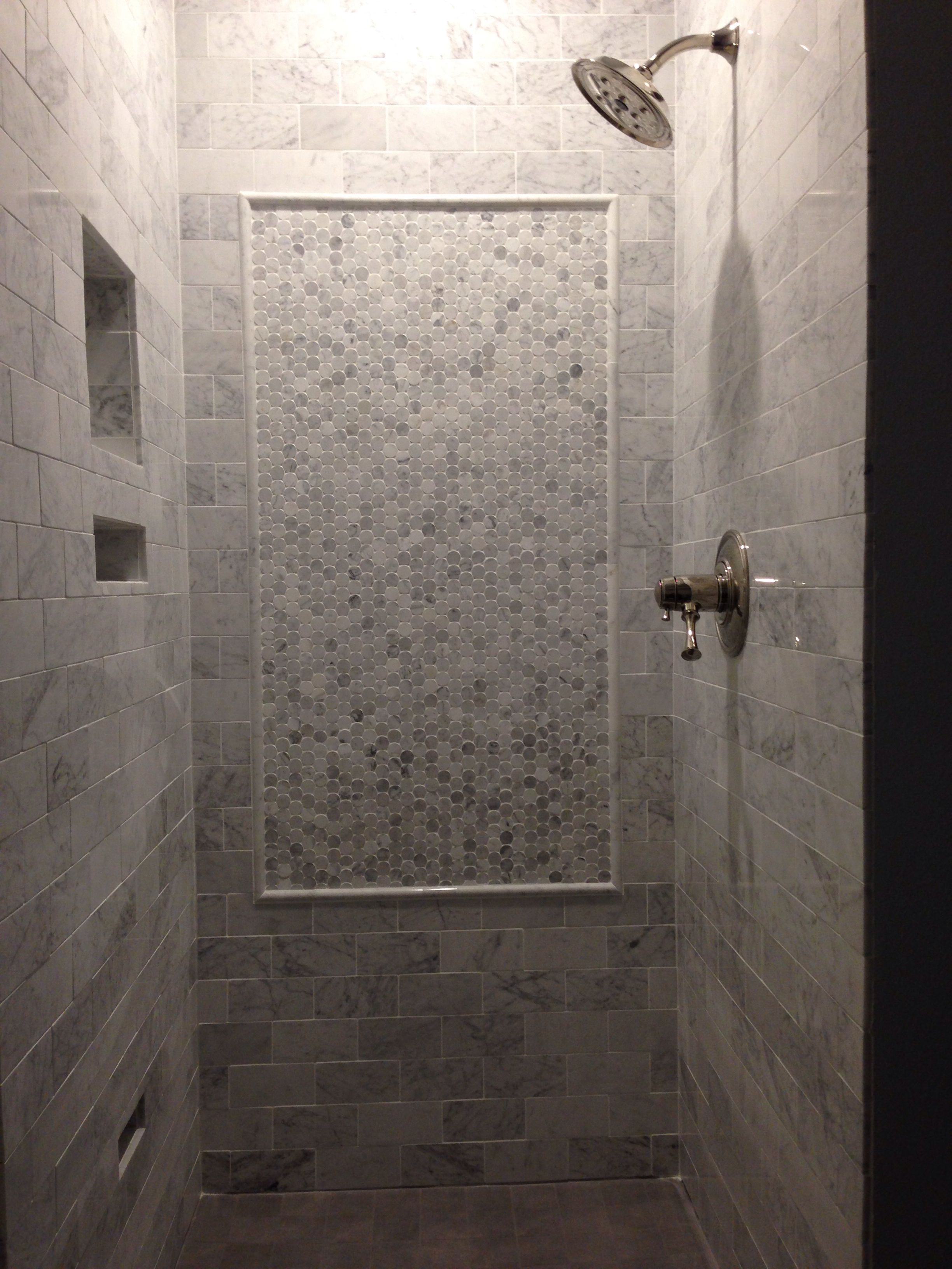 Carrera Marble Subway Tile With A Marble Penny Tile Inlay