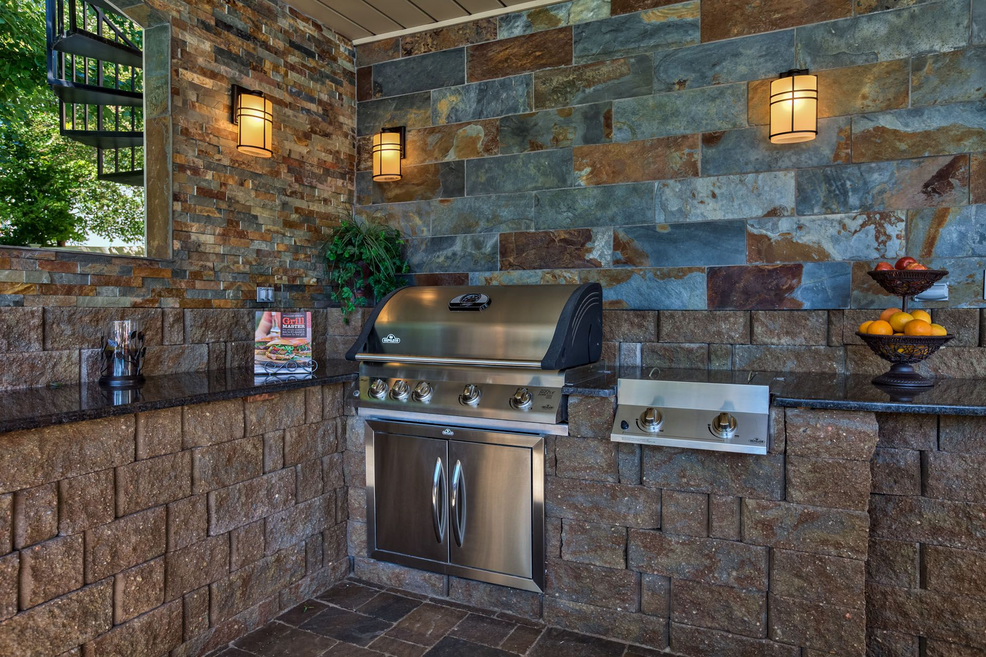This outdoor kitchen has beautiful tile work with a