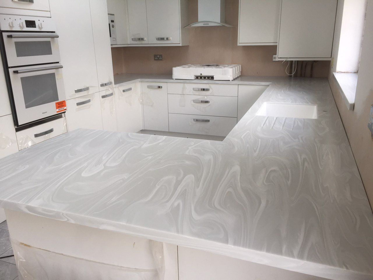 Corian Gray Onyx Countertops Are Pretty Corian Countertops Kitchen Bathroom Remodel Corian Kitchen Countertops