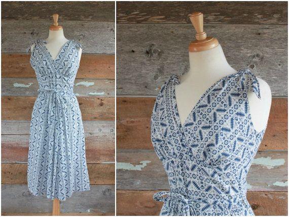 1950s sun dress by Swirl  1950s wrap dress  by FancyLuckyVintage