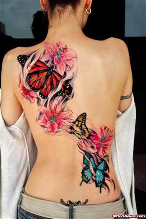 Butterfly And Colored Flowers Back Tattoo For Girls Butterfly Tattoos For Women Butterfly Tattoo Designs Butterfly Tattoo