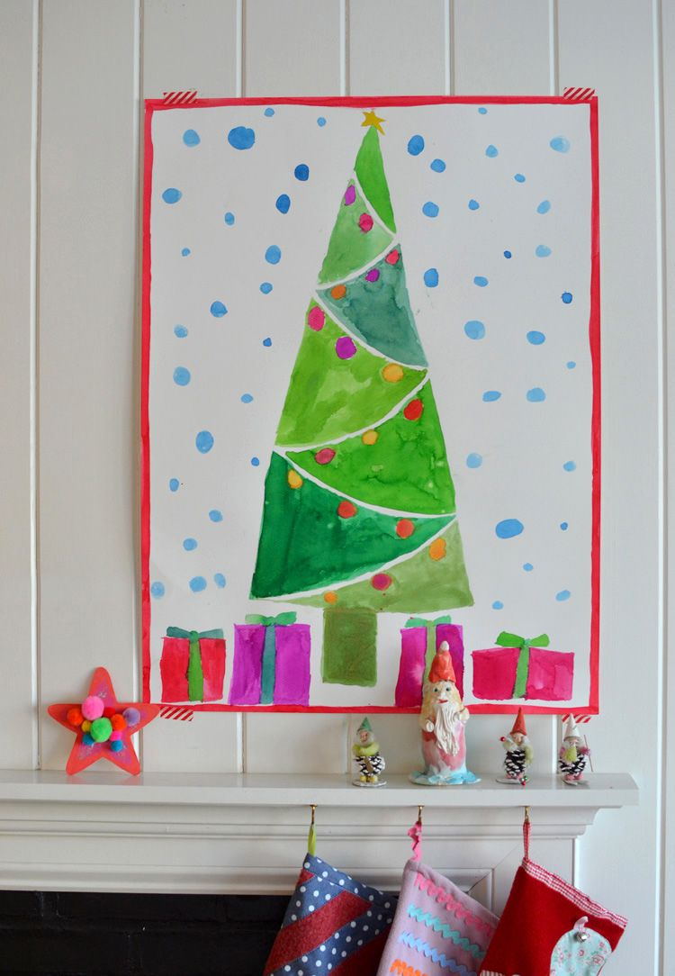 Children draw and paint giant Christmas trees