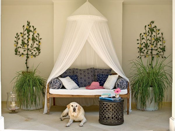 The Mosquito Net Canopy Relaxes This Formal Daybed Giving It An Exotic Air