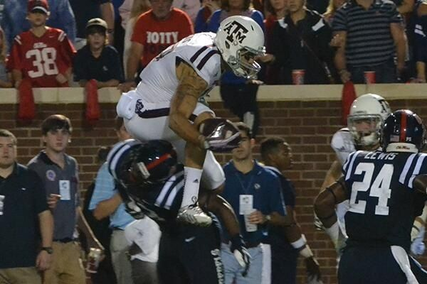 Mike Evans Hurdles A Human It S A Mcguffy Those Creek And Fair People Will Get It Mike Evans Aggie Football Gig Em Aggies