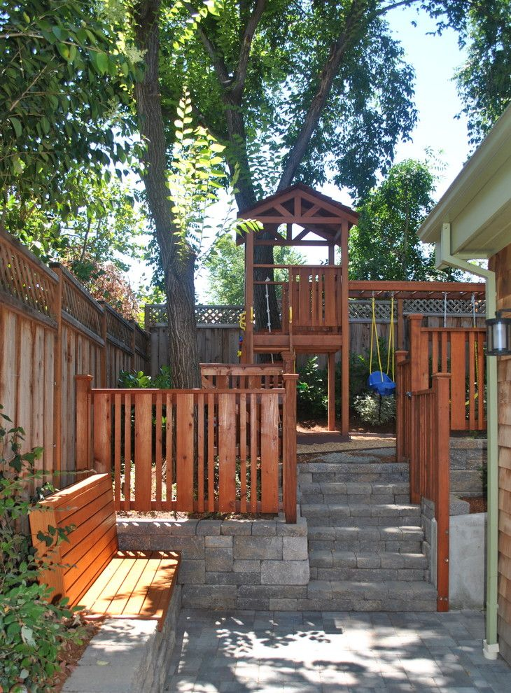 pretty backyard playground equipment in landscape traditional with swing set next to backyard fence alongside building - Backyard Playground Equipment