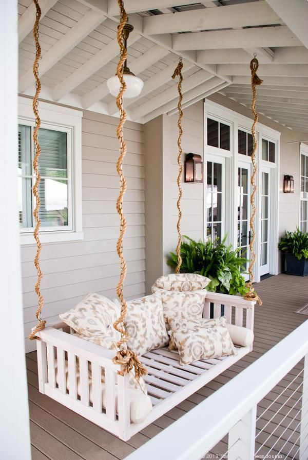 White Porch Swing Rope Porch Swing On The Front Porch Of The