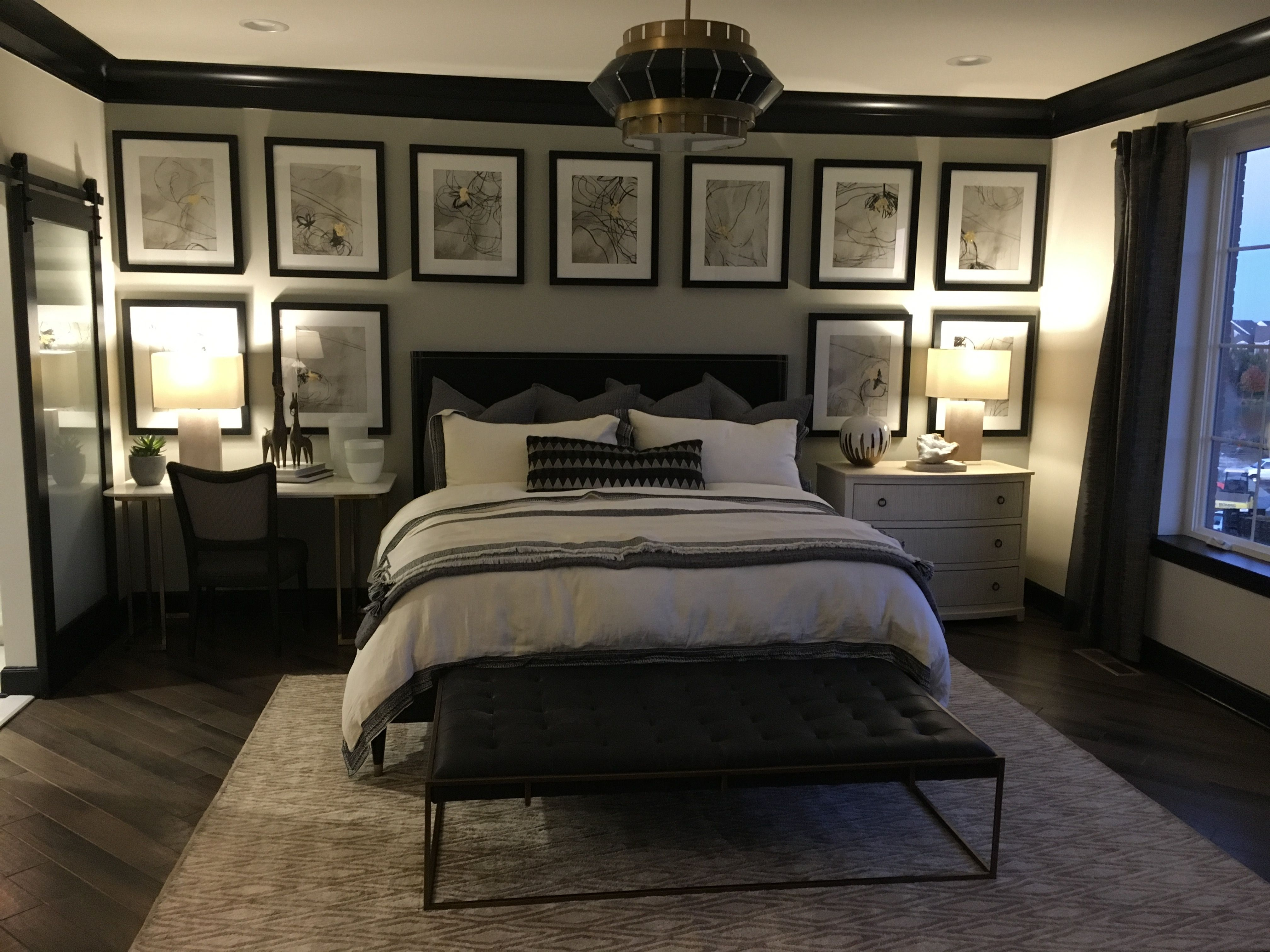 Master bedroom hand scraped wood floors gray black trim