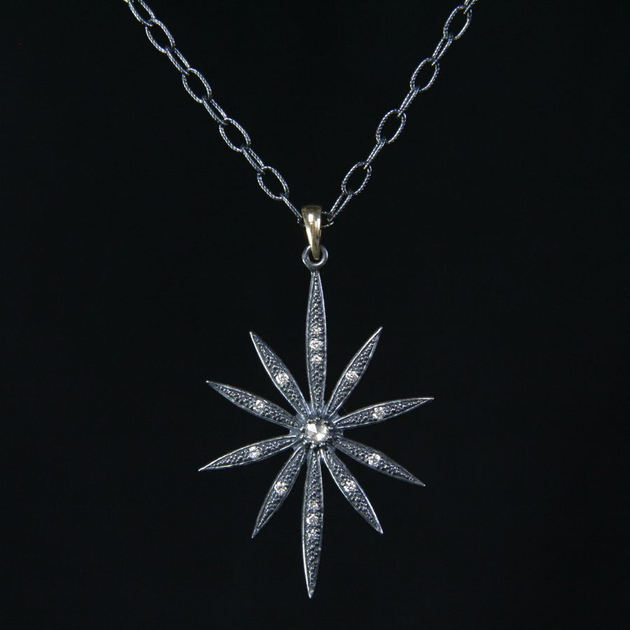 """Mizuki Shadow Flower Necklace Clasping 18"""" blackened Sterling Silver twisted wire chain and flower pendant with White Diamonds and 14K Gold accent.  Price $1,080.00 - See more at: http://goldbugpasadena.com/necklaces/mizuki-shadow-flower-necklace#sthash.vhyw4tCF.dpuf"""