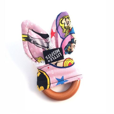 Down The Rabbit Hole Teether - Wonder Woman & Batgirl