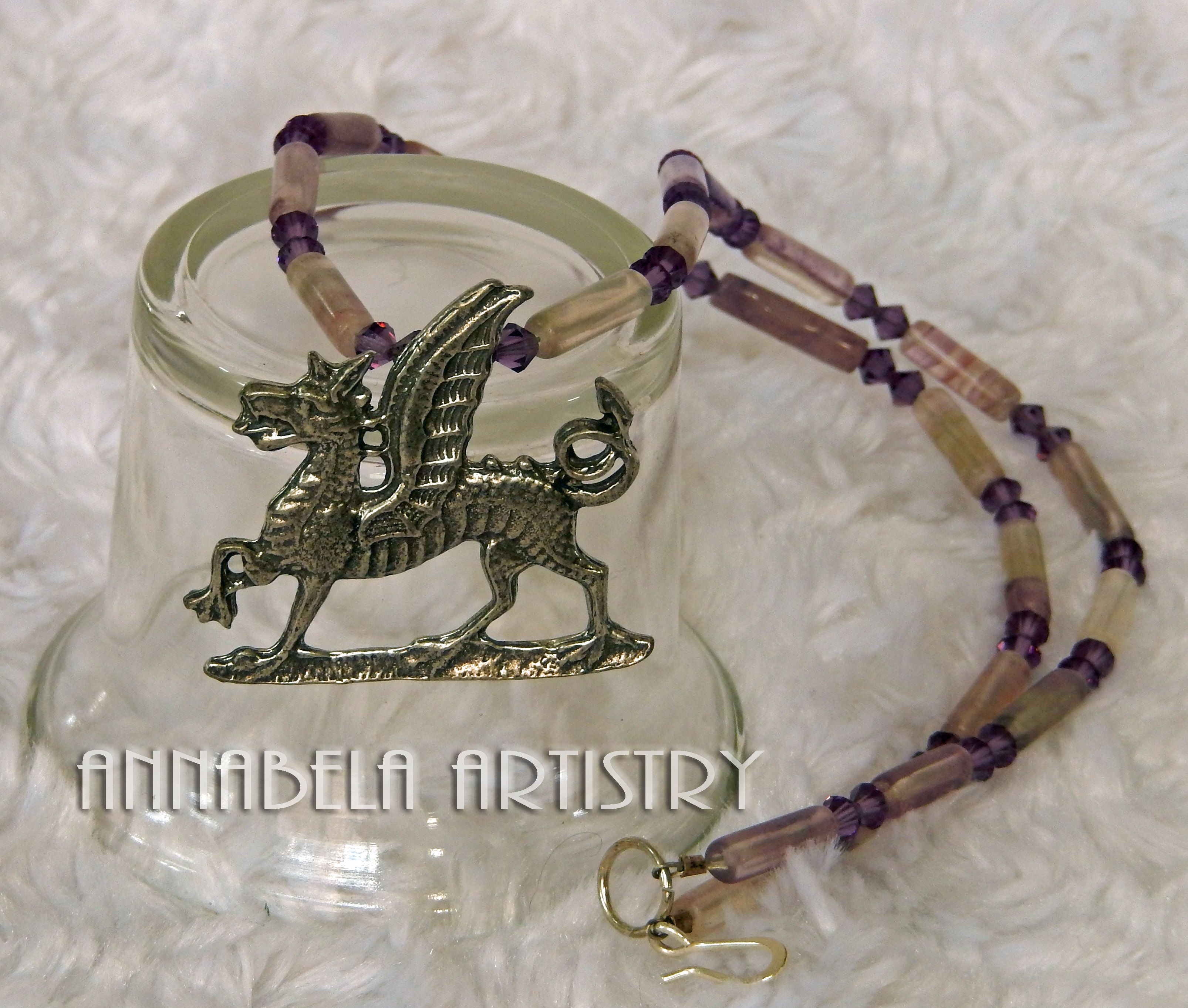 The gryphon pendant is made of pewter it has flourite gemstones and