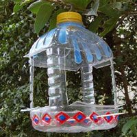 Diy plastic bottle bird feeder used empty squash and for How to make a bird feeder using a plastic bottle
