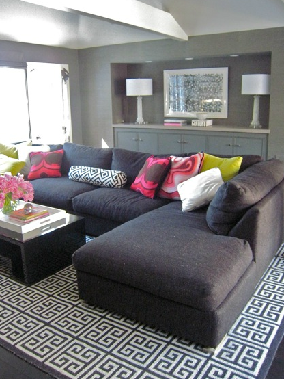Modern Gray Living Room Design With Charcoal Sectional Sofa And Jonathan Adler Greek Key Rug