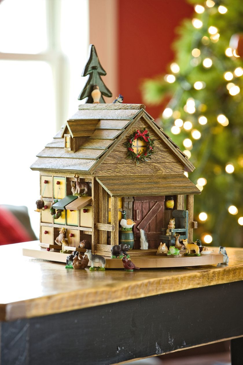 693ce4deeb7 Count down the days to Christmas with our woodsy cabin advent calendar  containing a menagerie of woodland animals. Twenty-three magnetic doors  swing open to ...