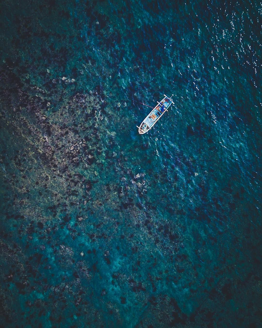 Pretty sure this fisherman is collecting Uni (Sea Urchin) from the safety of his boat!  I was diving in Izu today and I saw more Sea Urchin than fish! . . #dronestagram #dronelife