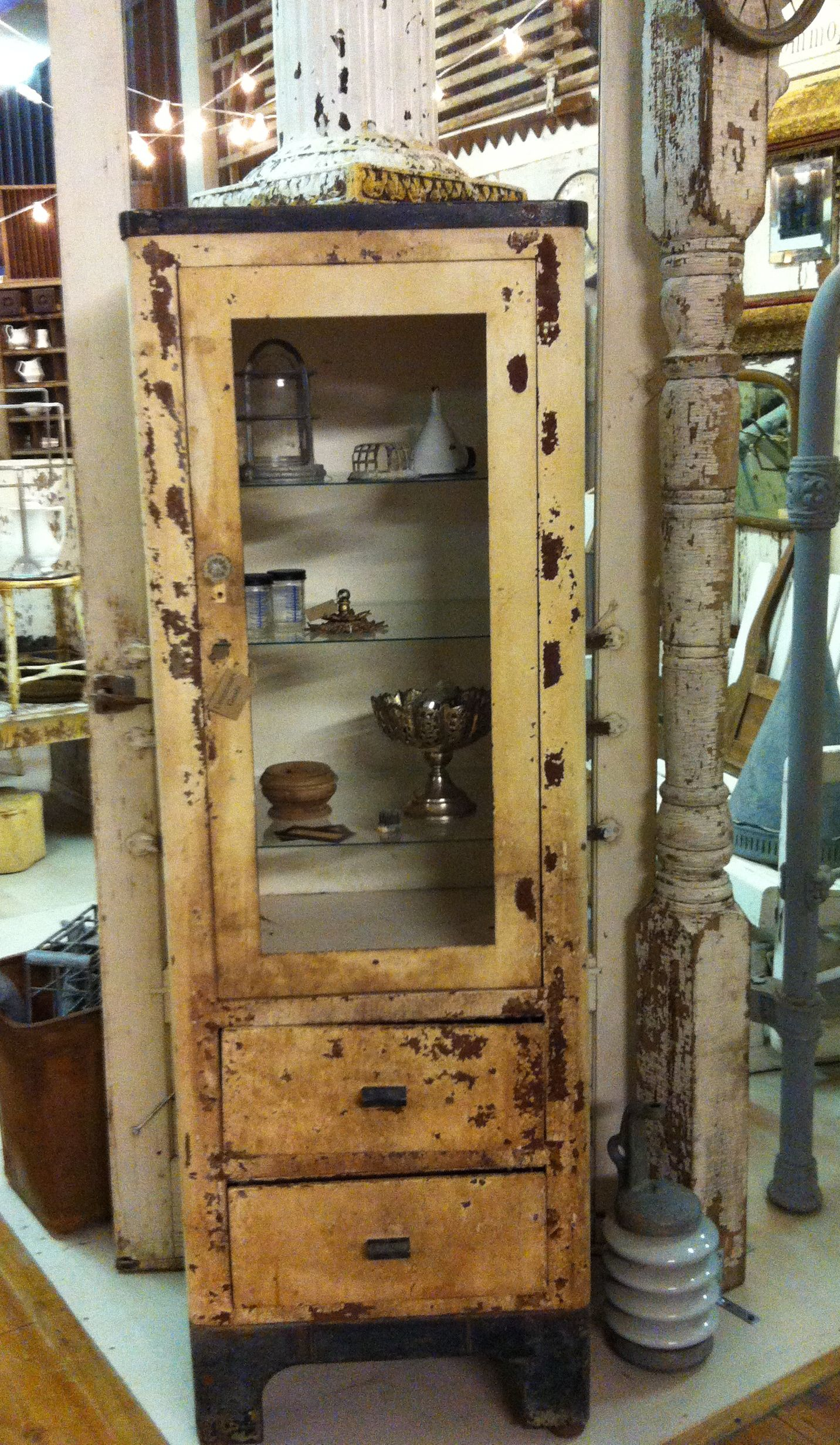An Antique Medical Cabinet Turned Into A Display Cabinet