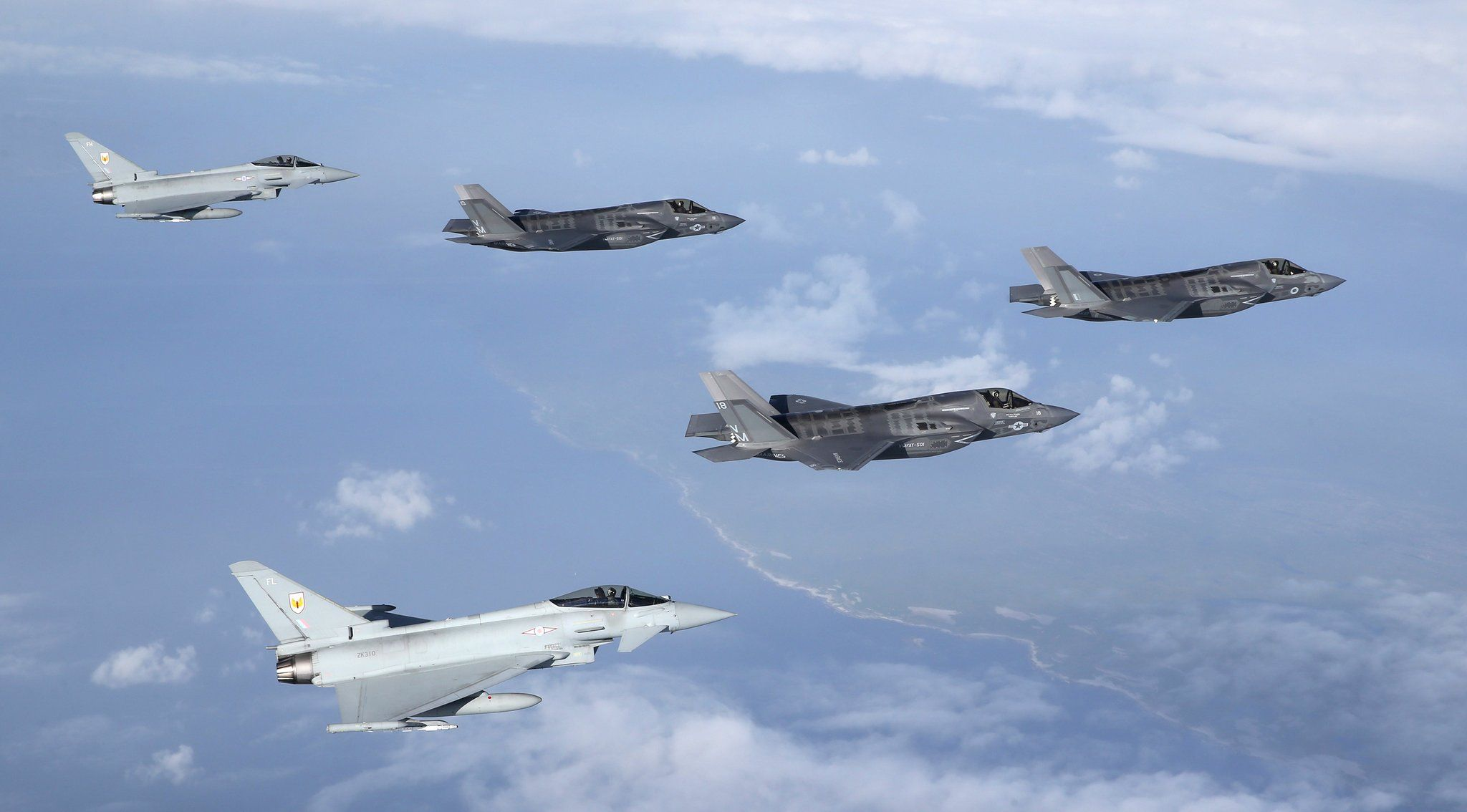 F35s arrive in the UK for the first time escorted by