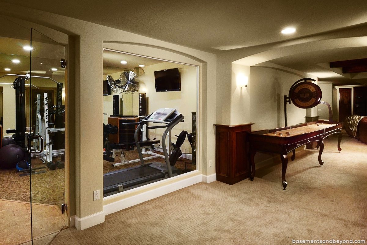 home gym decorating ideas with glass wall | Basement Exercise Room | View of the work-out room ...
