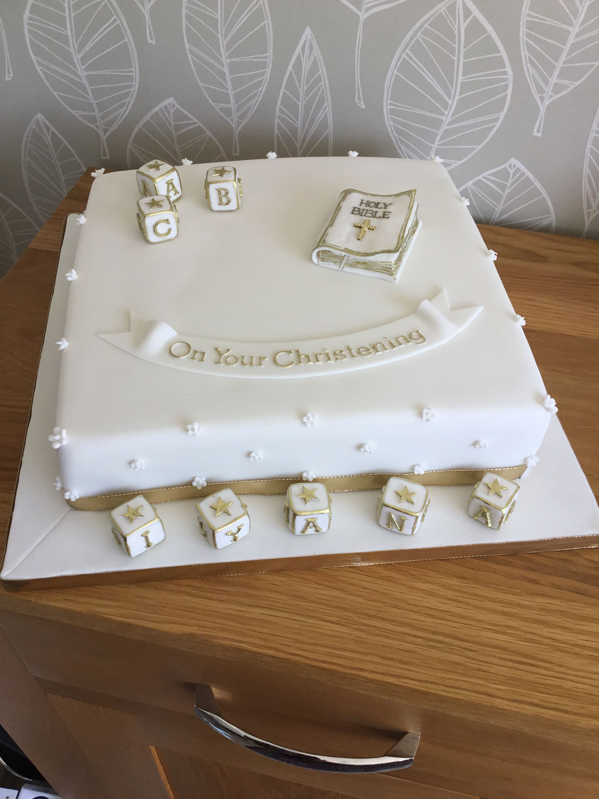 White and gold christening cake