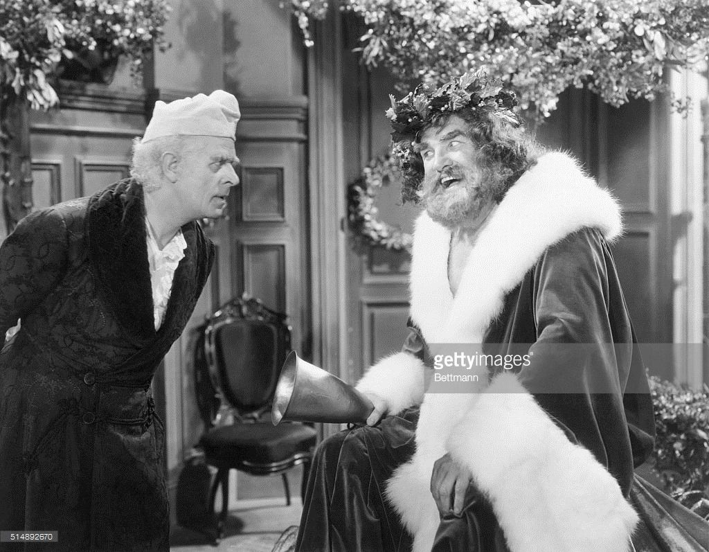 Reginald Owen, playing Scrooge, confronts the Ghost of