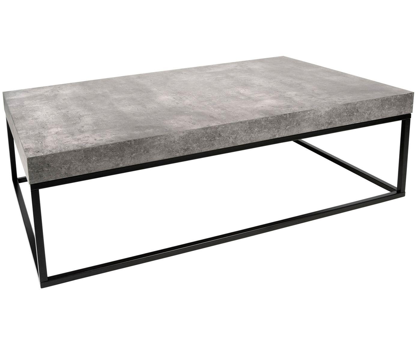 die schwarzen feinen tischbeine sind durch einen rahmen verbunden und bilden das gestell fur die graue tischplatte in beton optik