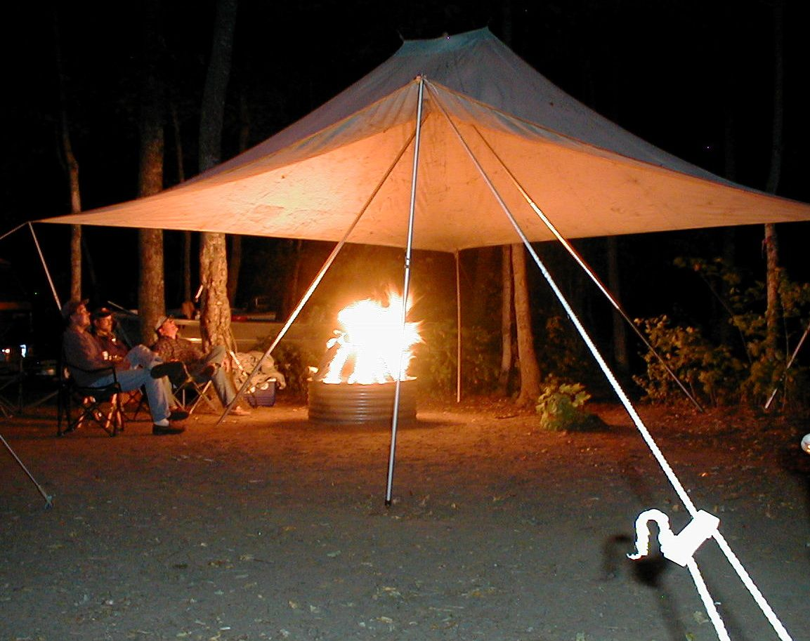 A tent for over a fire.with a big hole in the center ! & Fire Tent! A tent for over a fire...with a big hole in the center ...