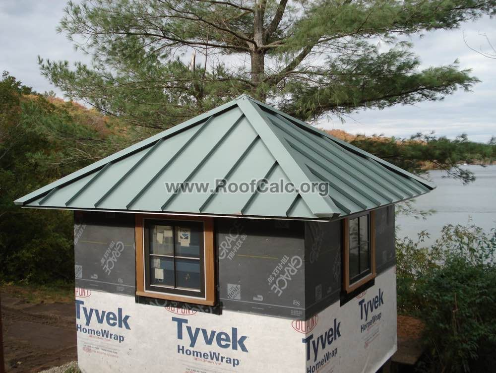 Pyramid Roof with Patina Green Standing Seam Metal Roof on a Lake