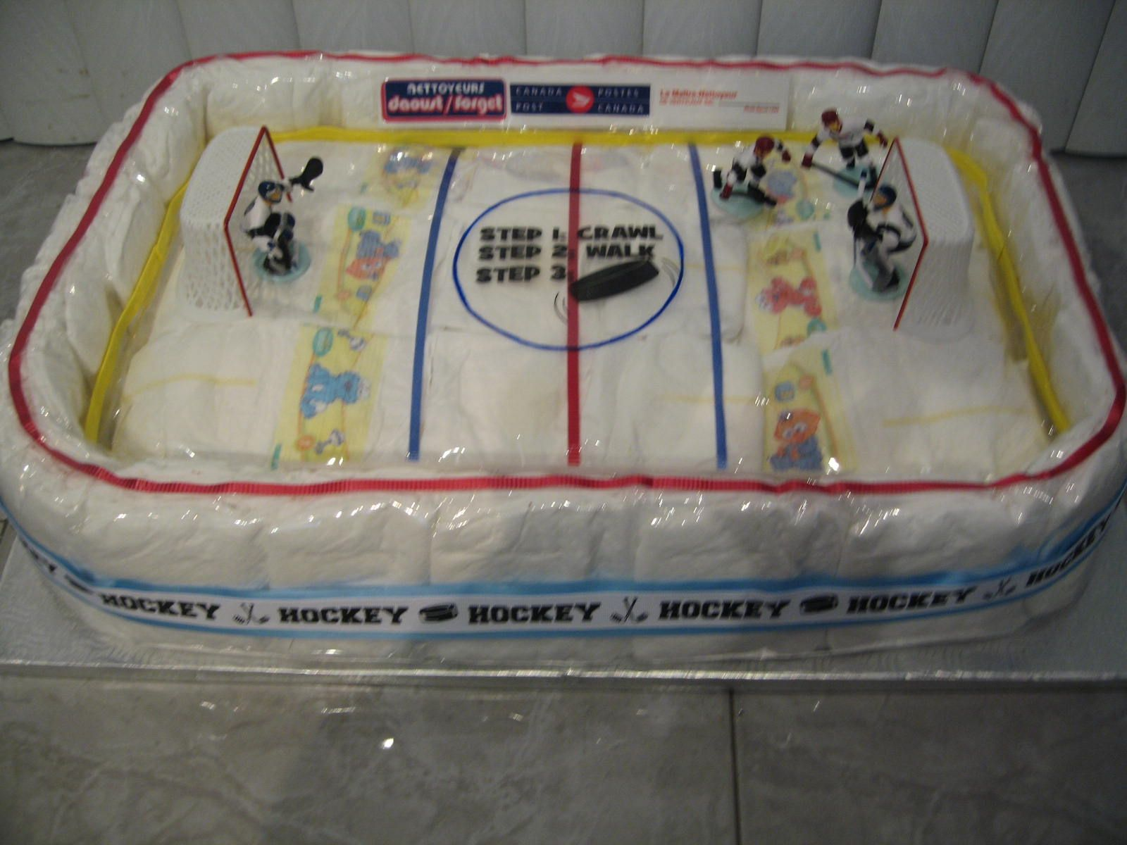 Ice Hockey Rink Diaper Cake Made By My Mom For My Cousin Who S Husband Is A Professional Hocke Baby Shower Party Decorations Baby Shower Cakes Baby Diaper Cake