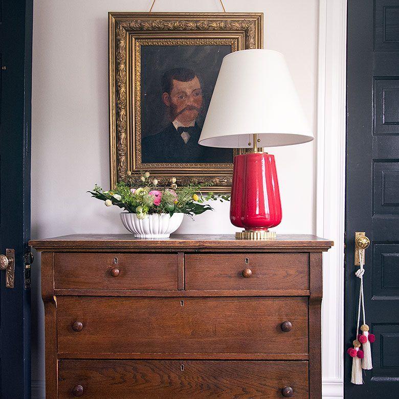 Vintage Wooden Dresser Between Black Painted Doors in the