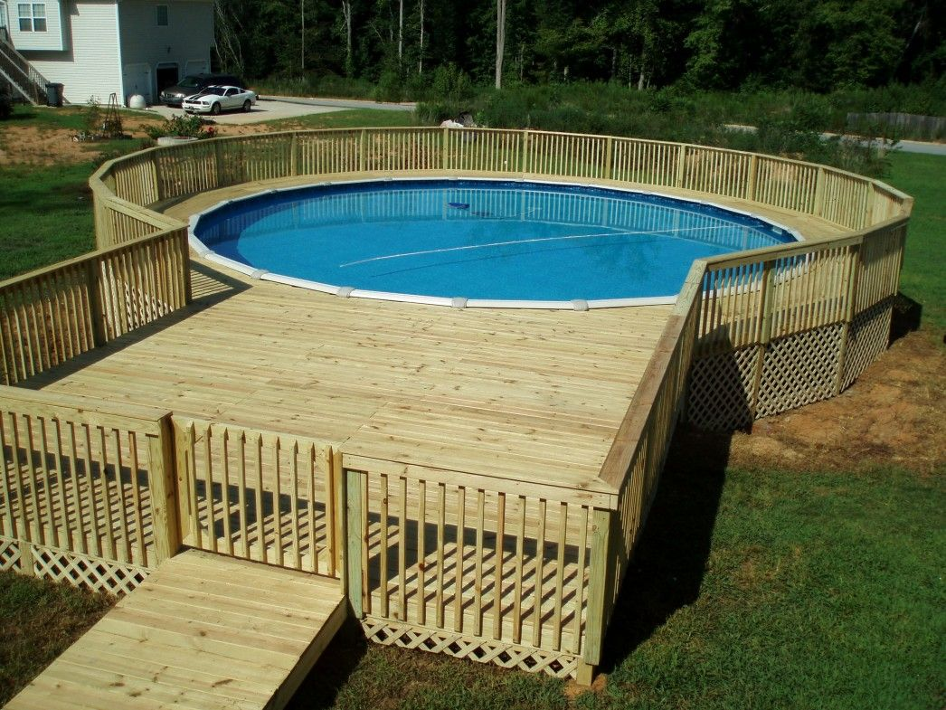 Natural Round Pool With Lap Pool In Deck Can Be Decor With Wooden