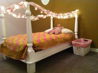 a toddler bed made from an upside down dining table found at goodwill
