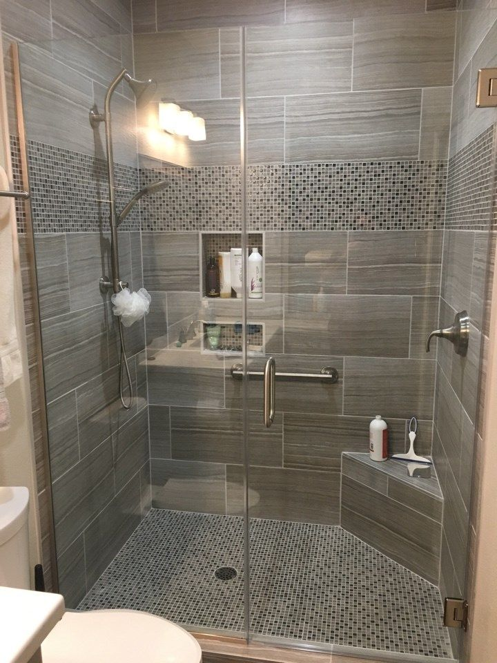 """12"""" x 24"""" tile on the shower walls with a glass and stone"""