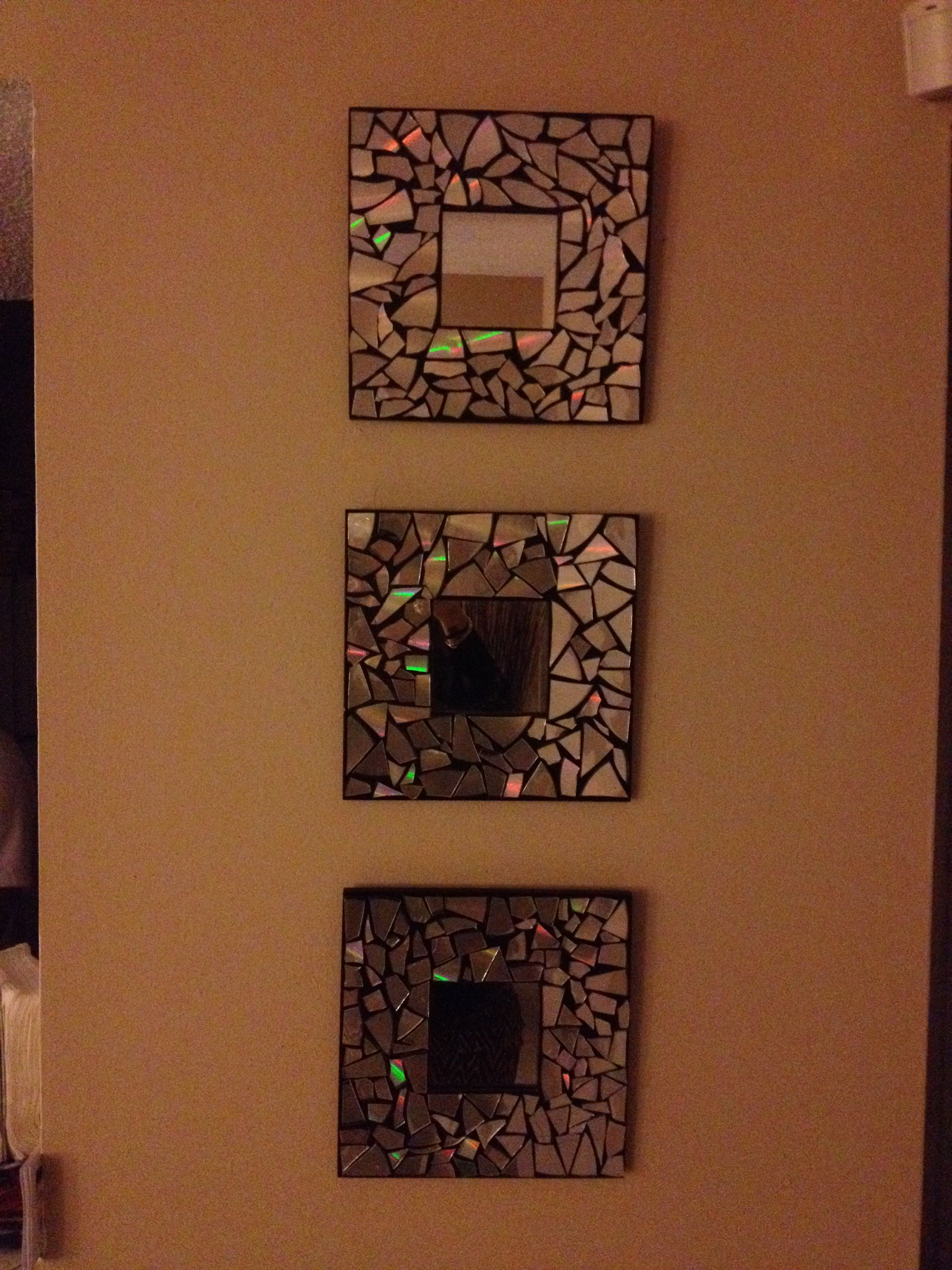 DIY: IKEA MALMA mirrors $1.99 each. Cut up some cd's and hot glue