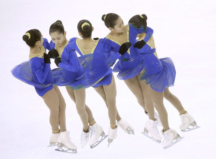 A multiple exposure shows Satoko Miyahara of Japan during a training session at the 2015 ISU World Figure Skating Championships at Shanghai Oriental Sports Center in Shanghai