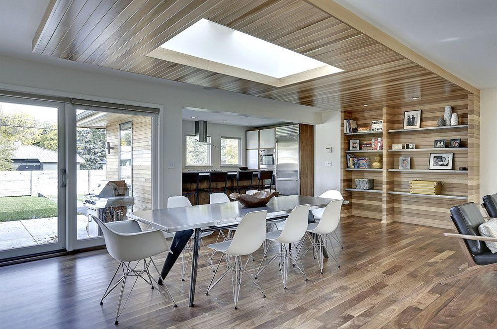 Peterssen/Keller designed a cedar centerpiece that wraps around a double skylight, then continues down the wall to form built-in bookshelves. .