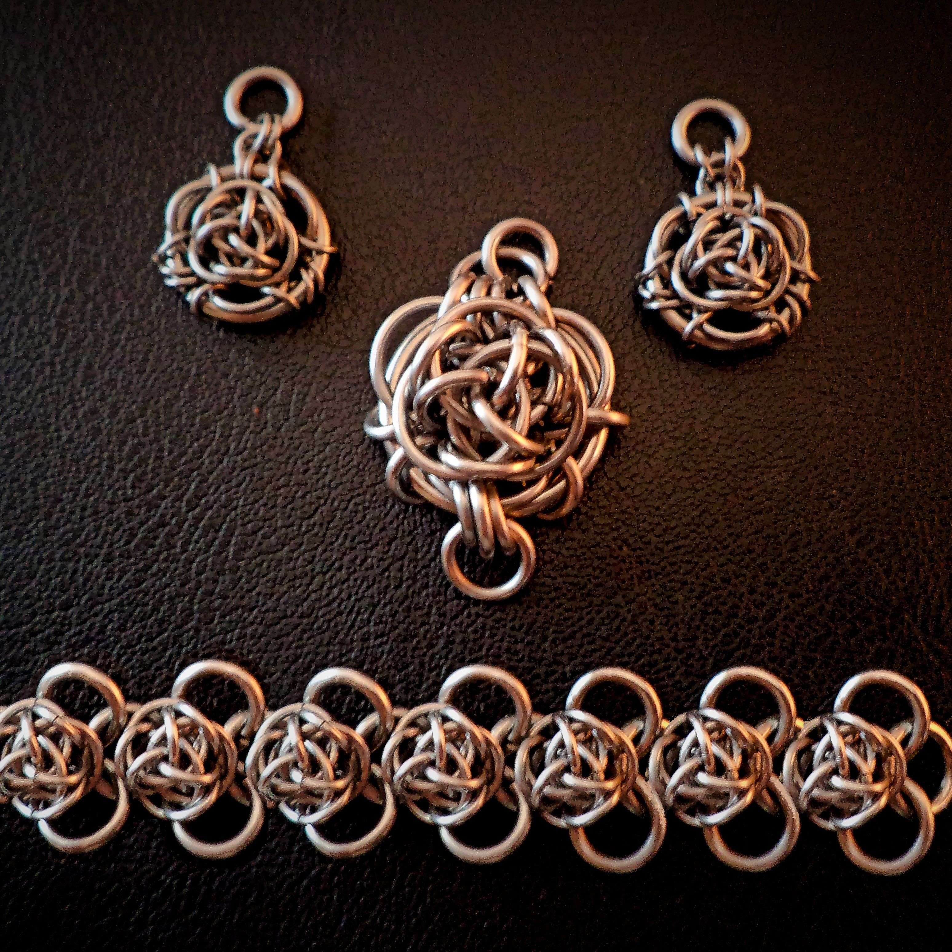 I've been playing with my Wild Rose Pendant design. Here is an earring set (without the ear wires as I am waiting on my order of surgical stainless ear wires to arrive), Wild Rose Heart Pendant for a necklace, and Wild Rose Bramble Bracelet in Stainless Steel.  https://www.facebook.com/BrilliantTwistedSkulls?fref=nf