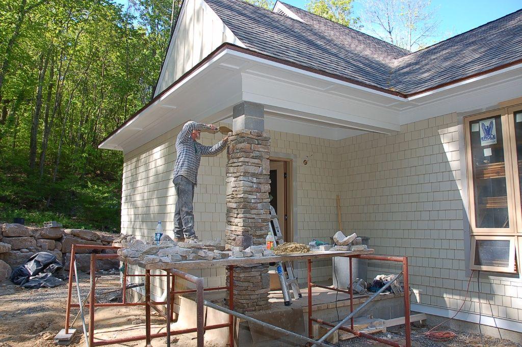 cultured stone facing the exterior porch columns | s p a c e ...