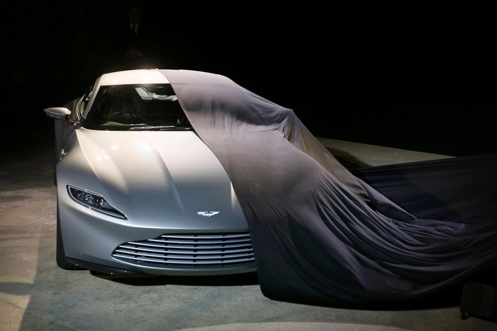 an aston martin db10 car is unveiled on stage during an event to rh pinterest com