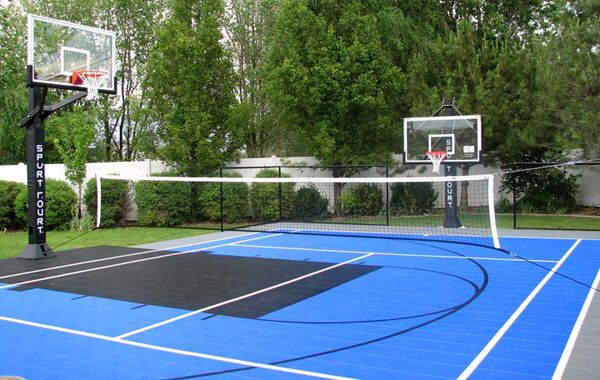 Sport court with two adjustable height basketball hoops for Sport court