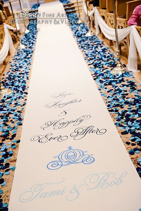 Dark blue and light blue petals line the aisle at Disney\'s Wedding ...