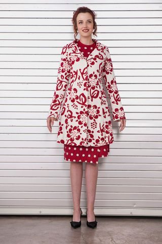 *Love*   Alabama Chanin: This 100% organic lightweight cotton jersey coat is elaborately hand-stitched in Daisy pattern. Flares slightly at the waist. Shown here in Natural with Carmine appliqué.