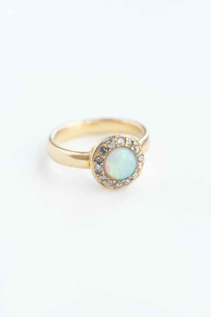 Antique Opal and Diamond Ring - Fourteen rose-cut diamonds surround a dazzling round opal and are resin set in 18k yellow gold. We suspect this antique ring is English circa 1895-1905, and lov - from QUITOKEETO.com
