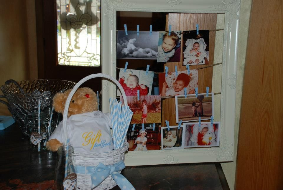 Pictures of Mommy and Daddy. The bear is dressed in the outfit Mom and Dad gave to Gammie to announce we will have a baby.