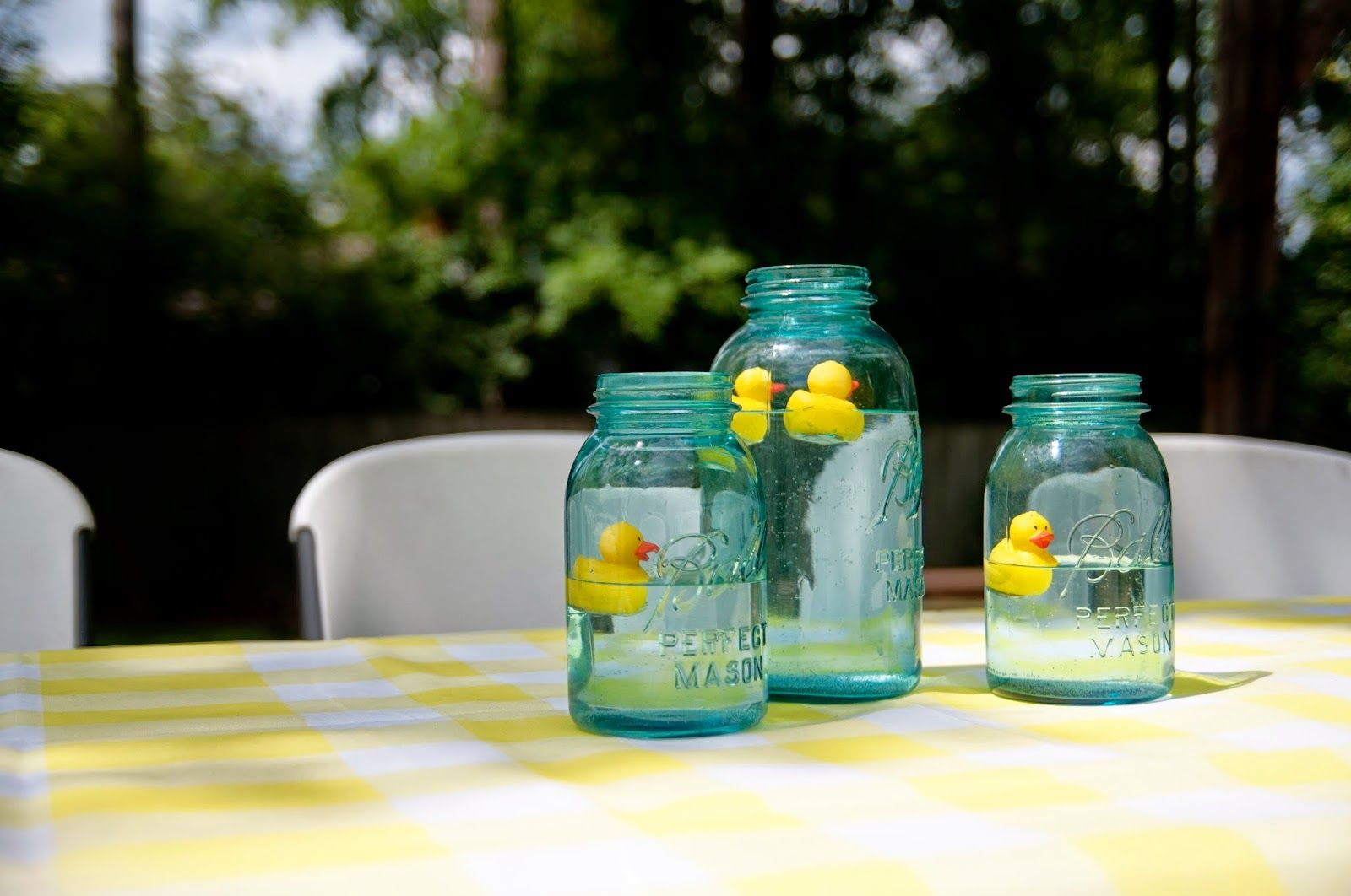Rubber duckie in blue mason jar table centerpiece celebrate
