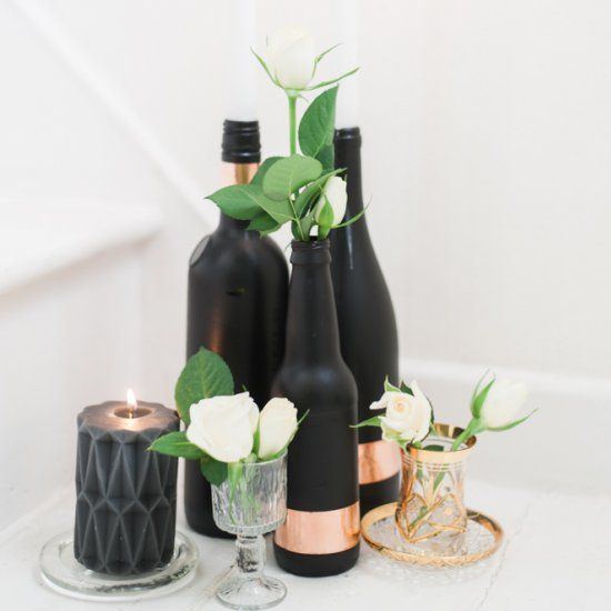 Add a touch of luxe to your tables with these easy to DIY black bottles and a lush rose gold band.