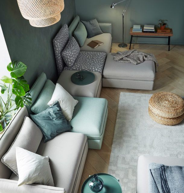 A sofa combination in beige and green, that seats five, consisting of corner…