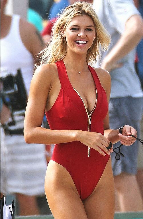 9bdf54c1718 Kelly Rohrbach in the upcoming Baywatch movie - click ahead for more of the  most iconic swimsuits in pop culture